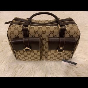 Gucci speedy hand bag with authenticity tag
